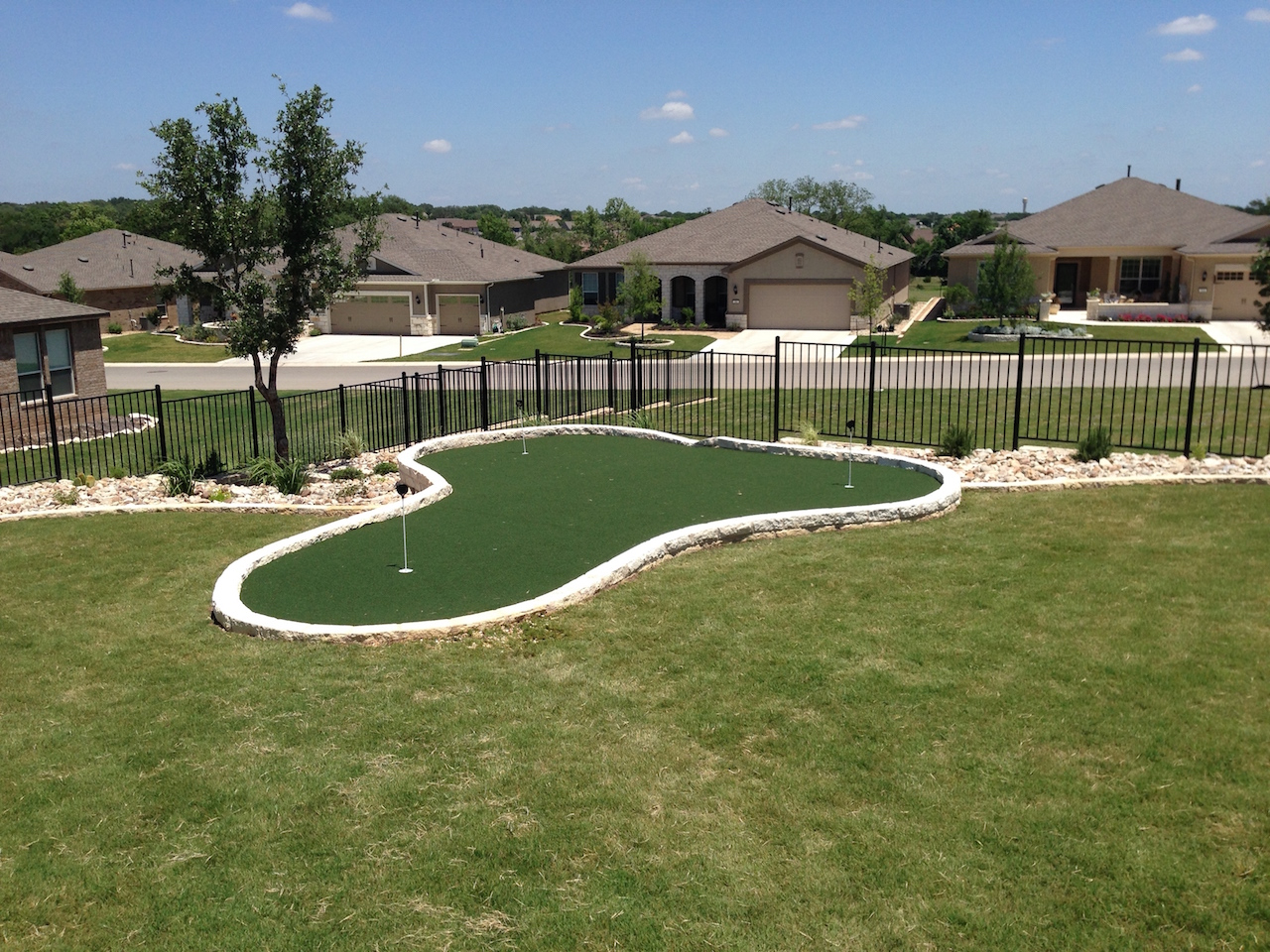 putting greens for golf enthusiasts texas custom turf
